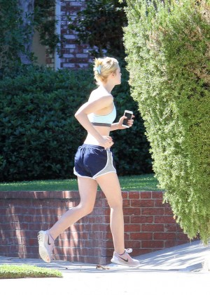 Elle Fanning in Shorts and Sports Bra -01