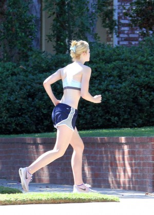 Elle Fanning in Shorts and Sports Bra -11