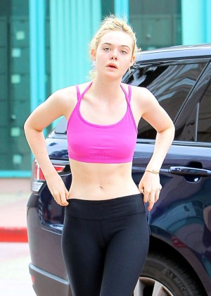 Elle Fanning in Pink Top and Leggings Going to the gym in LA