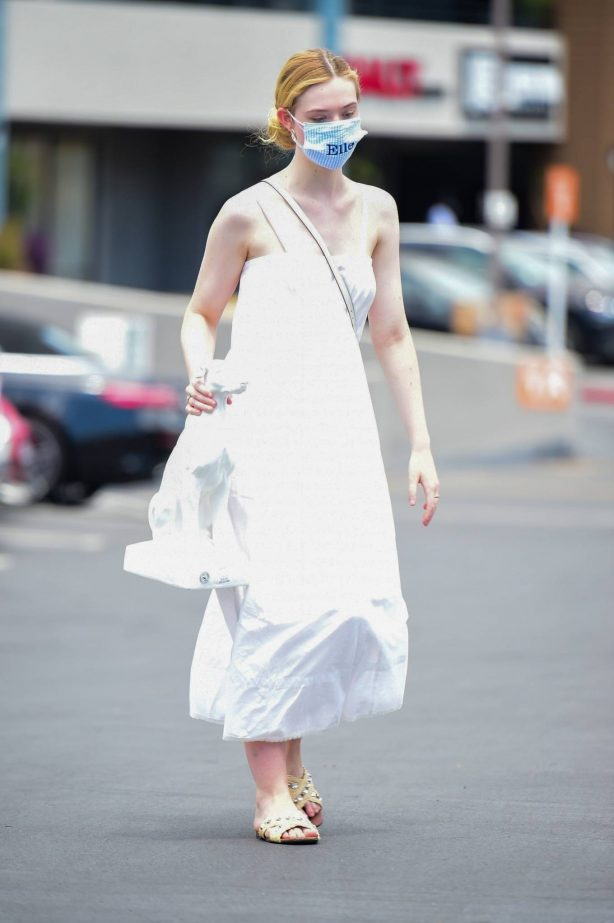 Elle Fanning - In a white maxi dress shopping in Los Angeles