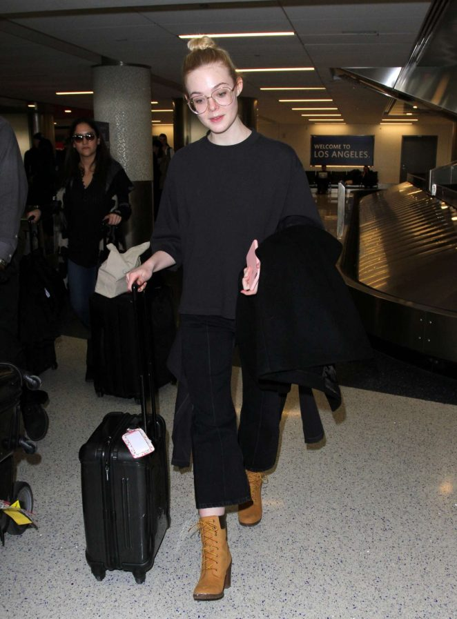 Elle Fanning in Black outfit at LAX Airport in LA