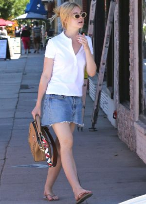 Elle Fanning in Jeans Mini Skirt a Nail Salon in West Hollywood