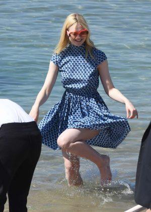 Elle Fanning in Mini Dress on the beach in Cannes