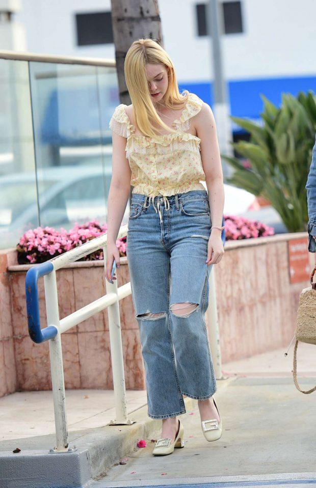 Elle Fanning in Ripped Jeans-04