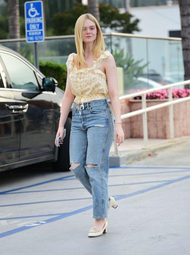 Elle Fanning in Ripped Jeans-18