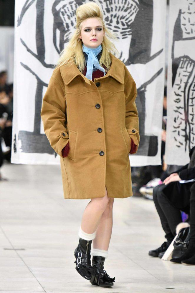 Elle Fanning - Miu Miu Womenswear Show Runway 2018 in Paris