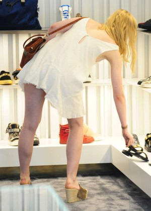 Elle Fanning in Short Dress at Giuseppe Zanotti in Beverly Hills