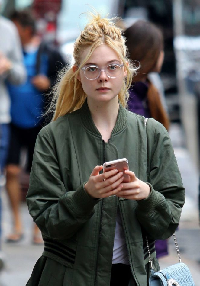 Elle Fanning - Sports stylish glasses in Manhattan