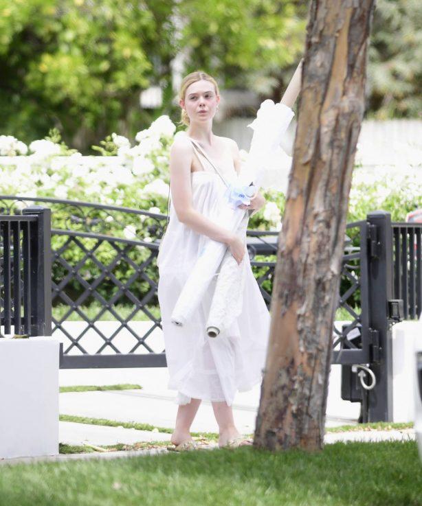 Elle Fanning wears a flowing white dress in Los Angeles