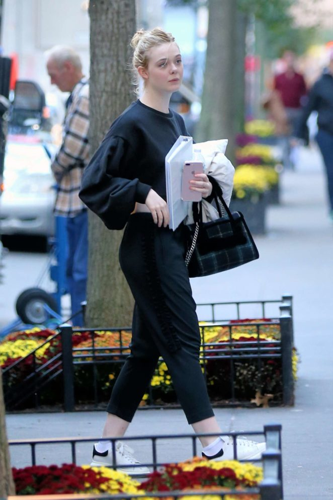 Elle Fanning with her favorite pillow out in NYC