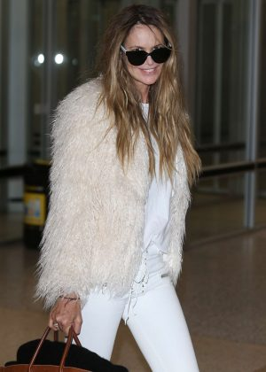 Elle Macpherson - Arrives at airport in Melbourne