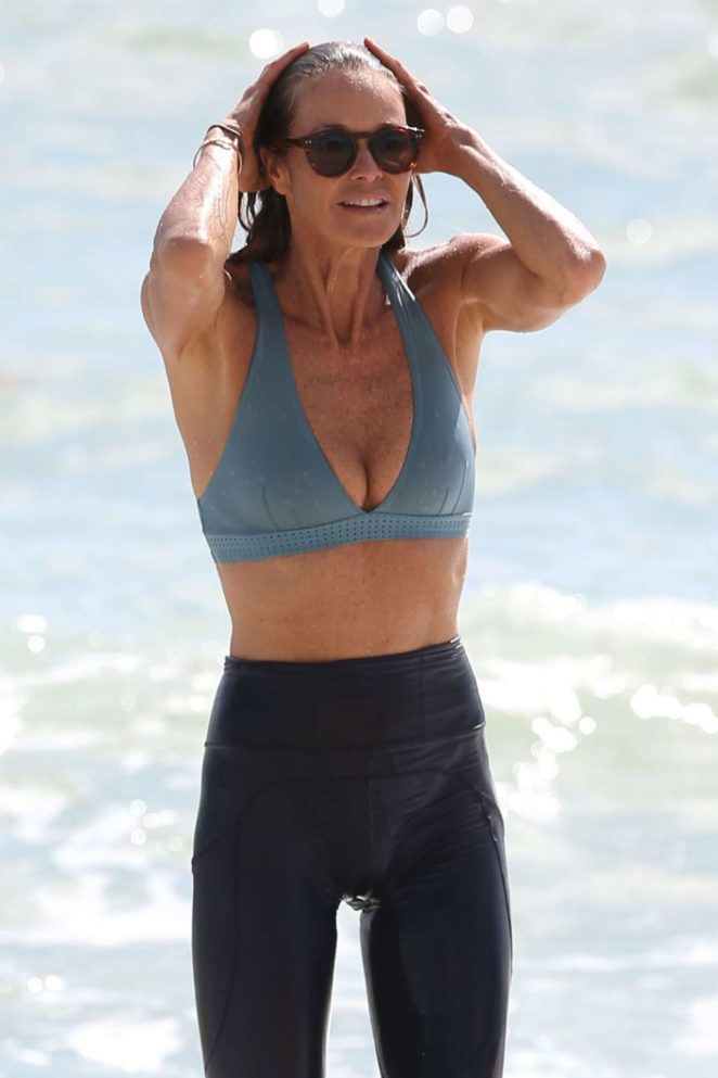 Elle Macpherson in Bikini Top on the beach in Miami