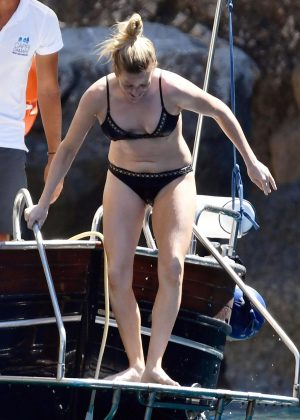 Ellie Goulding in Black Bikini at a Boat in Capri