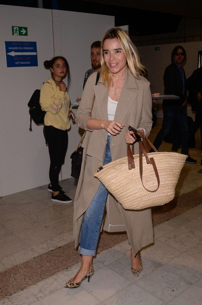 Elodie Bouchez Arrives at Airport in Cannes