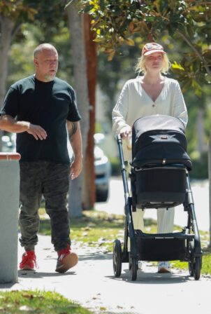 Elsa Hosk - takes a walk with her baby in LA