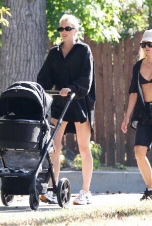 Elsa Hosk - Wears a black tuxedo shirt while on a stroll with her daughter in Pasadena