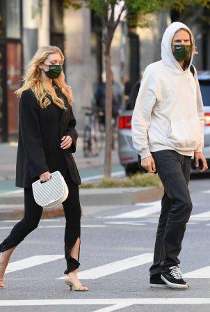 Elsa Hosk with her boyfriend walk in SoHo