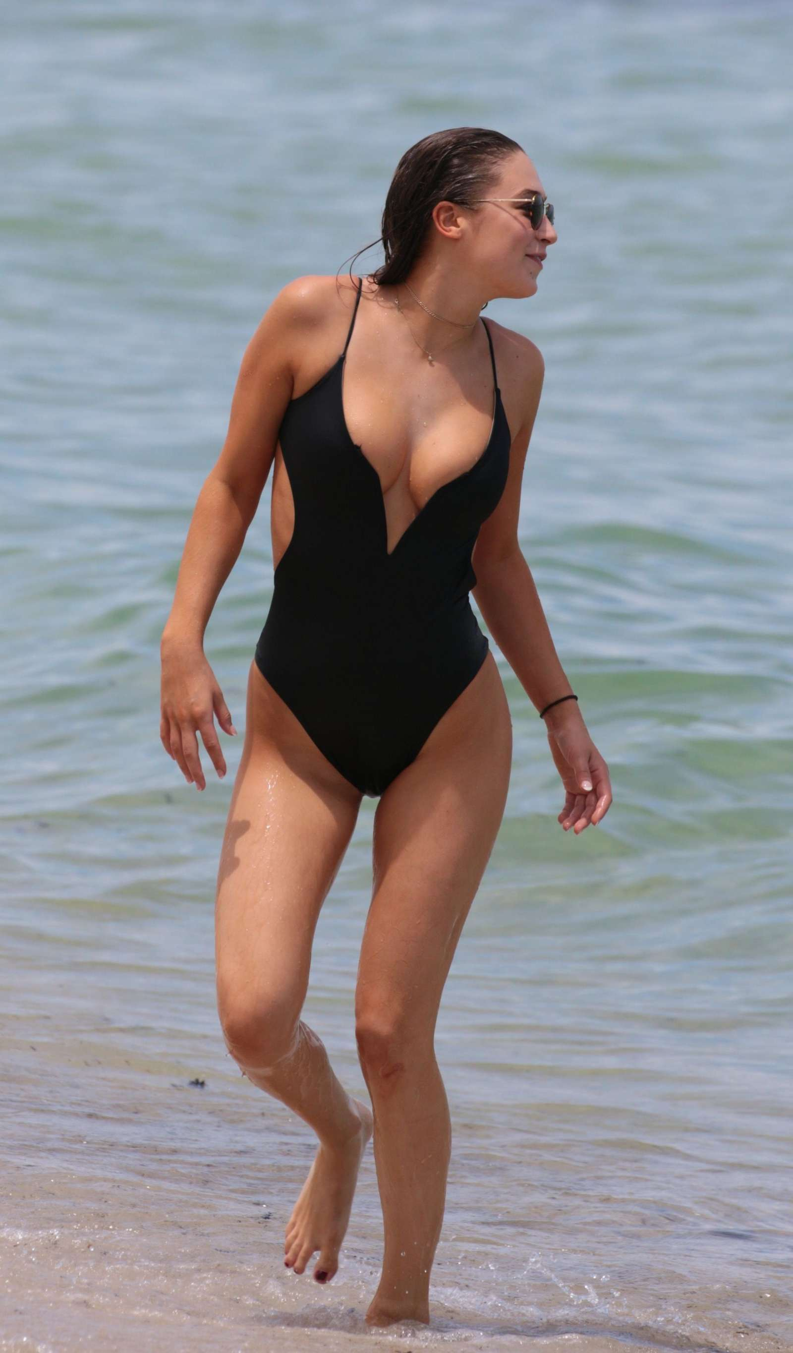 Elsie Hewitt In Black Swimsuit At The Beach In Miami