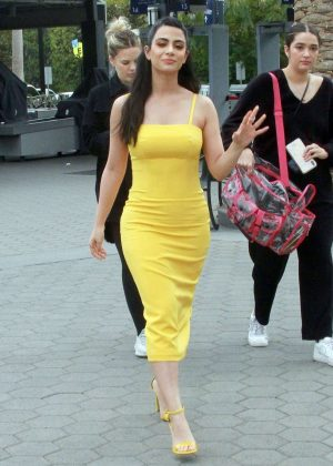 Emeraude Toubia in Yellow Dress on Extra at Universal Studios in Hollywood