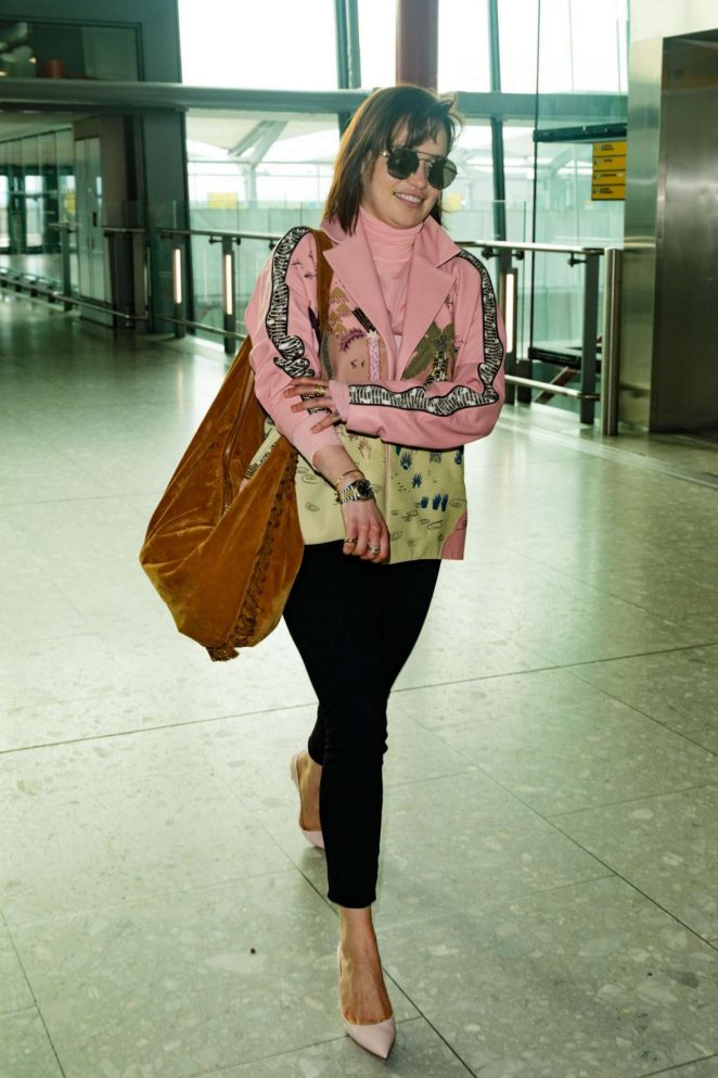 Emilia Clarke at Heathrow Airport -03