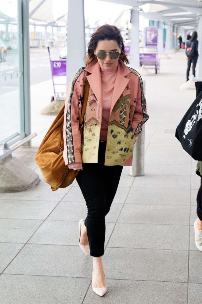 Emilia Clarke at Heathrow Airport -04