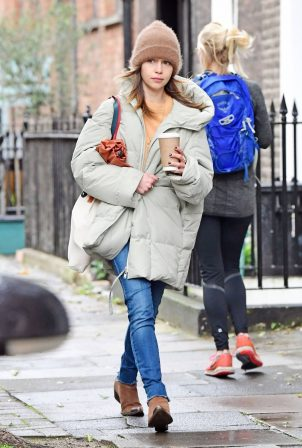 Emilia Clarke - In an oversized puffer jacket running errands in London