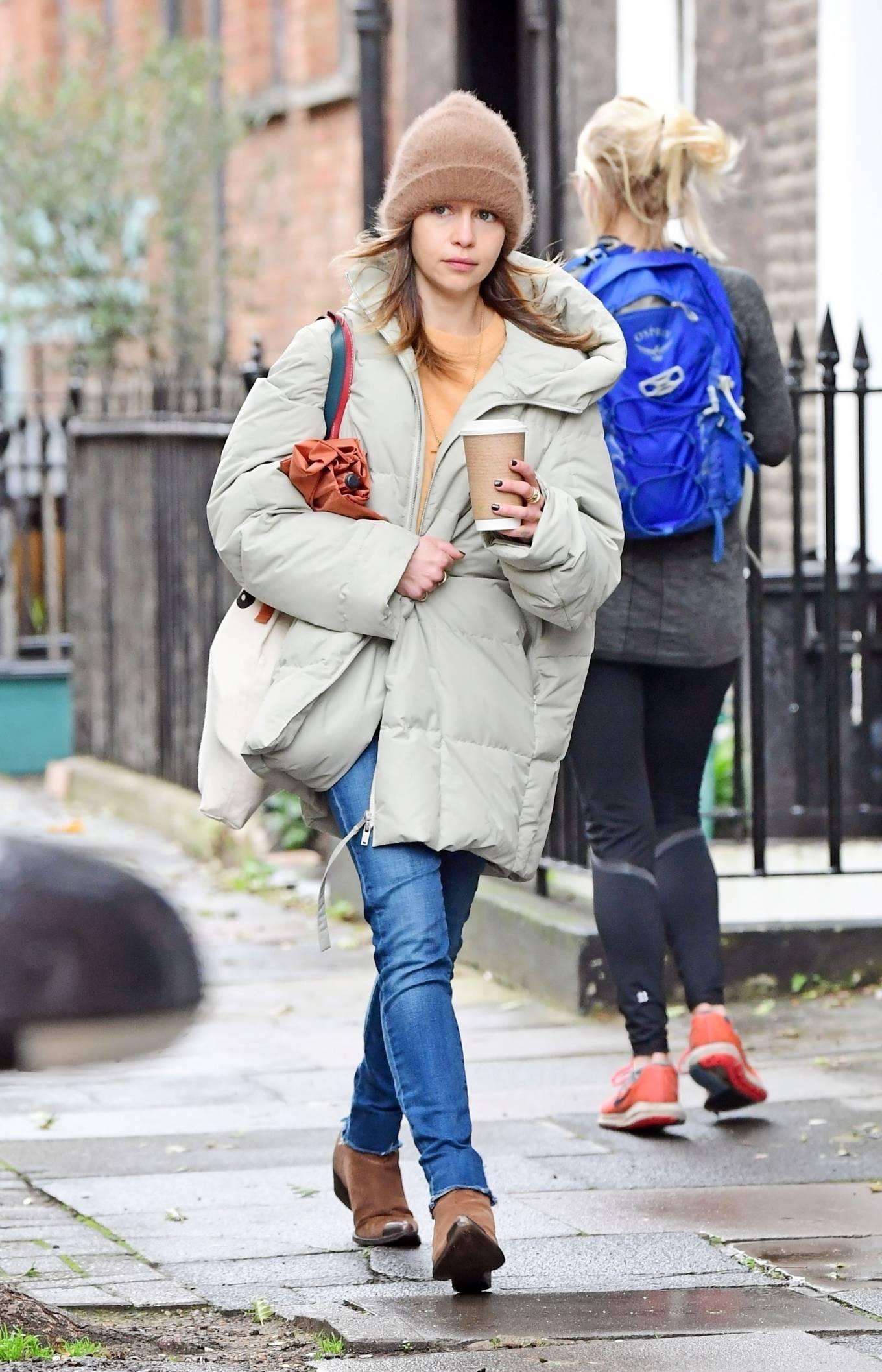 Emilia Clarke - In an oversized puffer jacket running errands in London