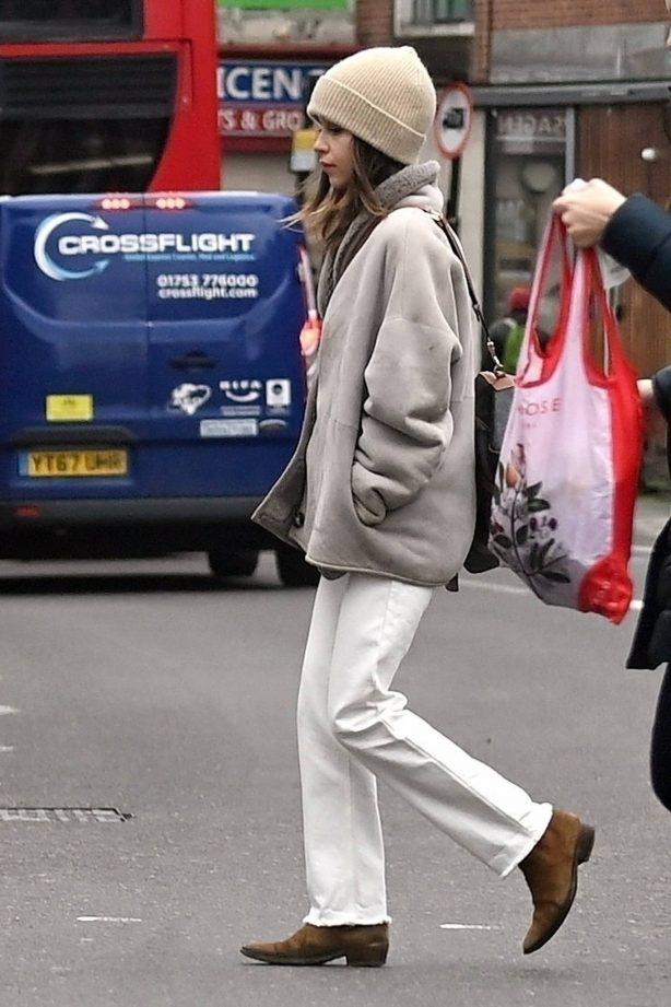 Emilia Clarke - running an errand in East London