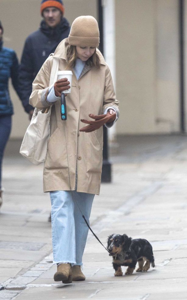 Emilia Clarke - Takes her dog for a stroll in London