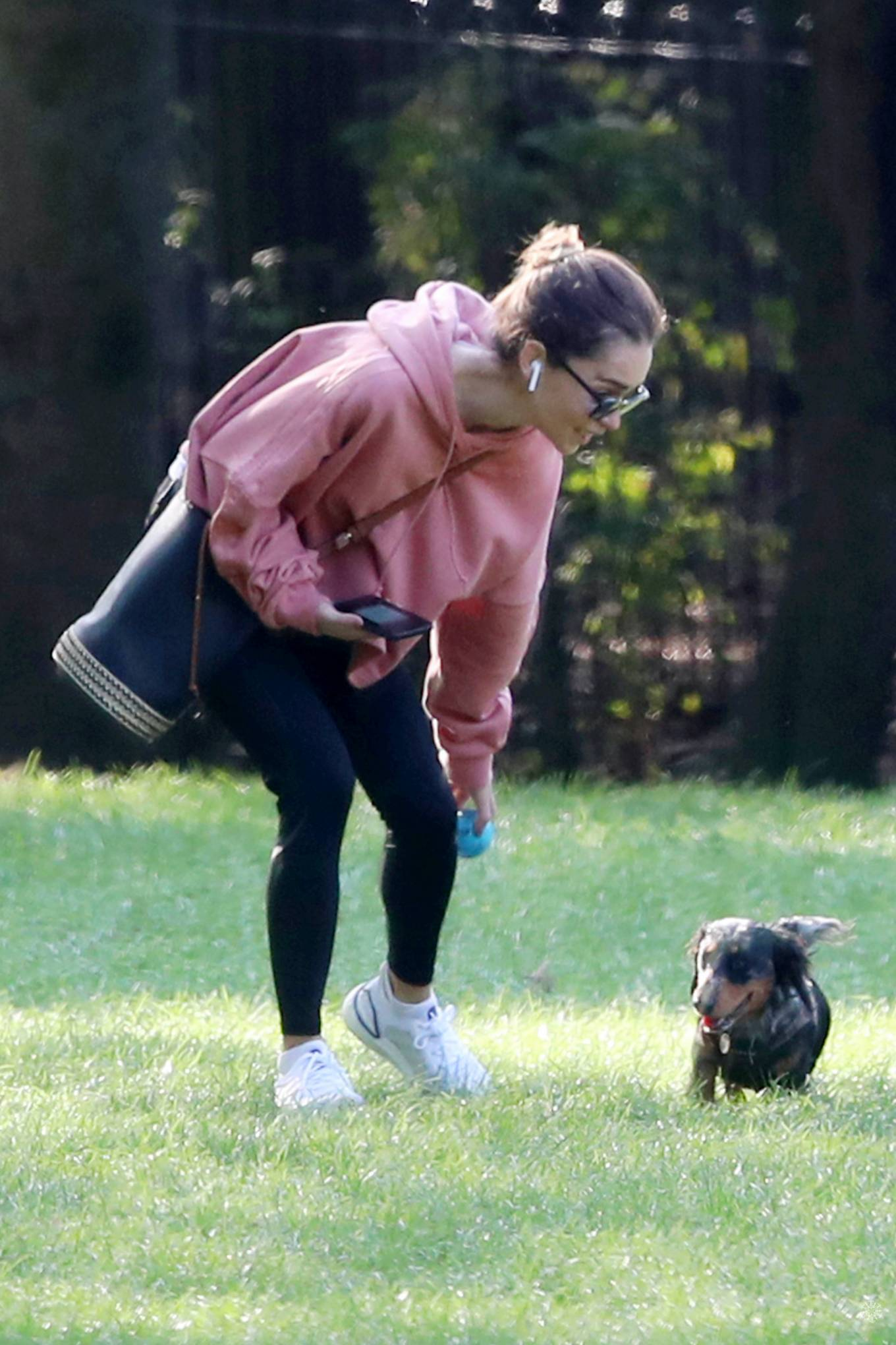 Emilia Clarke - Takes her dog to the park in London