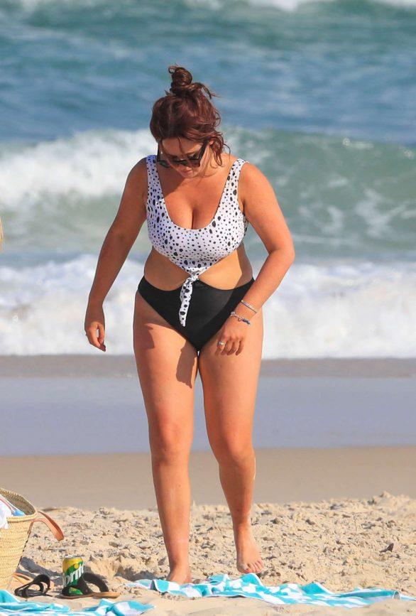 Emily Atack in Swimsuit on the beach in Australia