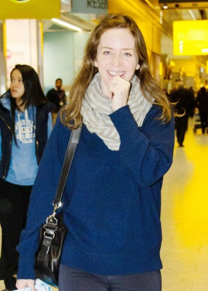 Emily Blunt with her husband at Heathrow Airport in London