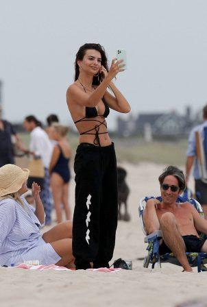 Emily Ratajkowski - In a bikini relaxes on the beach in The Hamptons