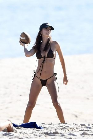 Emily Ratajkowski - In a black bikini playing football at the beach in East Hampton Hamptons