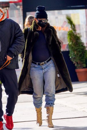 Emily Ratajkowski - In a black fur coat denim jeans and snakeskin boots in New York