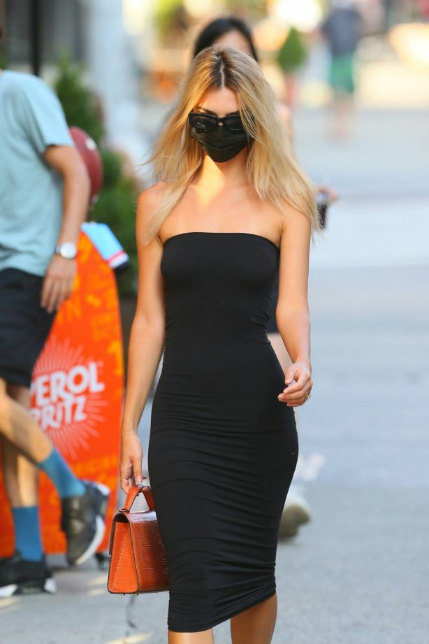 Emily Ratajkowski in a black strapless dress as she heads to dinner in New York