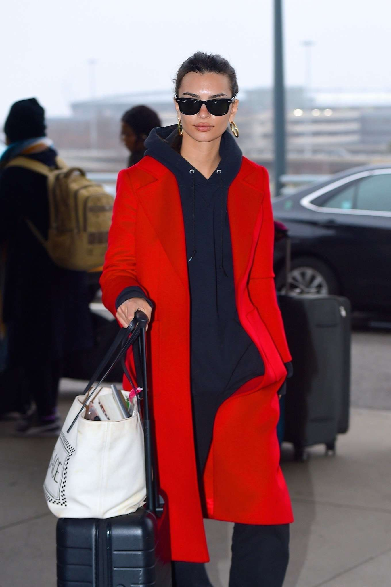 Emily Ratajkowski 2020 : Emily Ratajkowski in red coat ready for flight at JFK airport-08