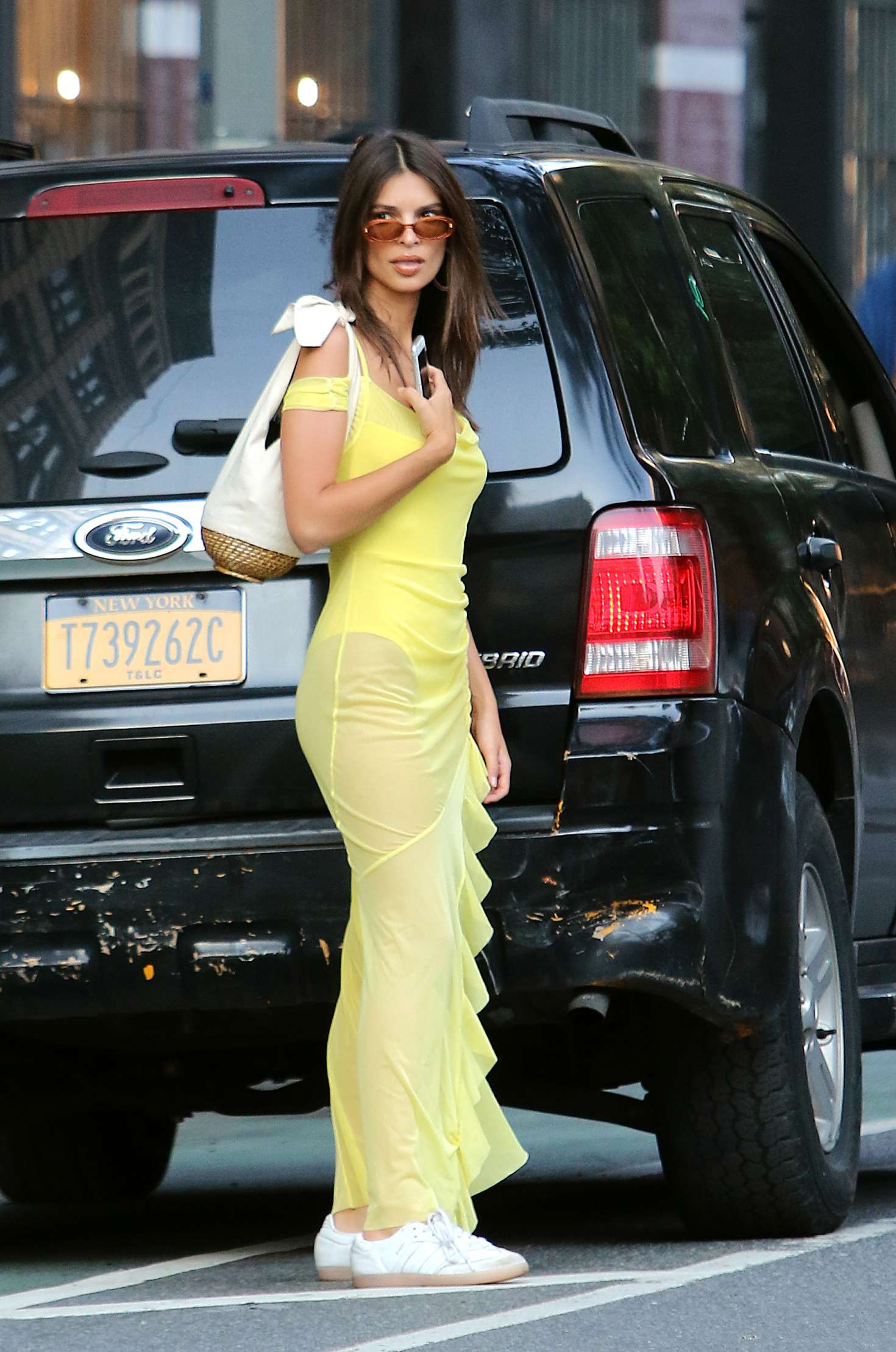 Emily Ratajkowski in Sheer Yellow Maxi Dress and Bodysuit in Manhattan
