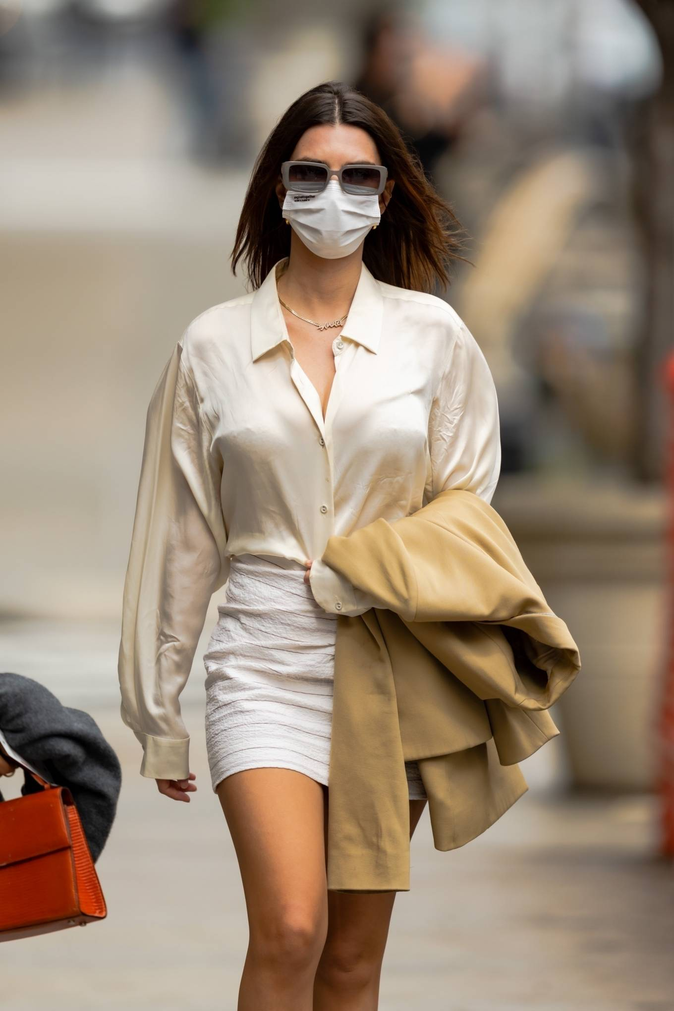 Emily Ratajkowski - In white mini skirt out for a walk in New York