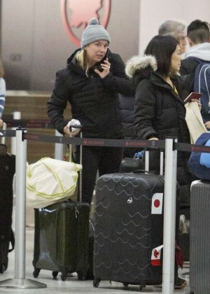 Emily VanCamp - Arrives at the airport in Toronto