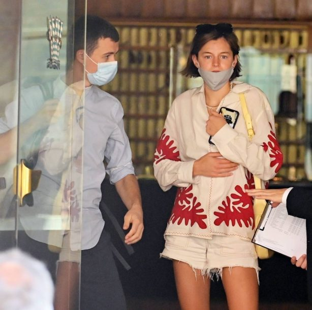 Emma Corrin leaves a hotel with a mystery man out in Venice