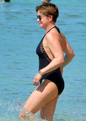 Emma Forbes in Black Swimsuit on the beach in Barbados