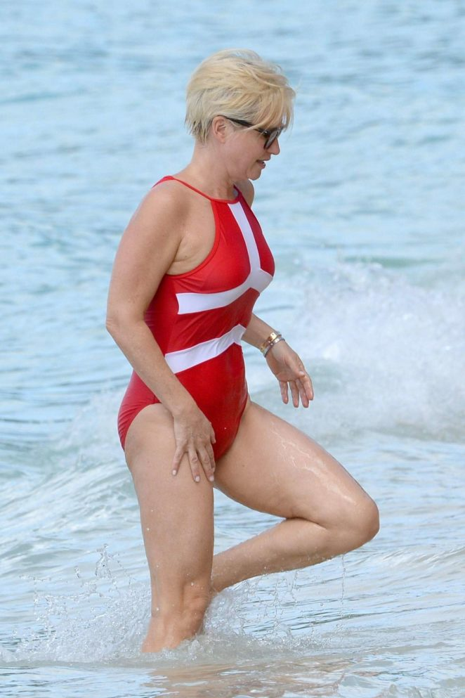 Emma Forbes in Red Swimsuit on the beach in Barbados