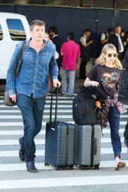 Emma Roberts and Garrett Hedlund - Arrives at LAX International Airport in LA