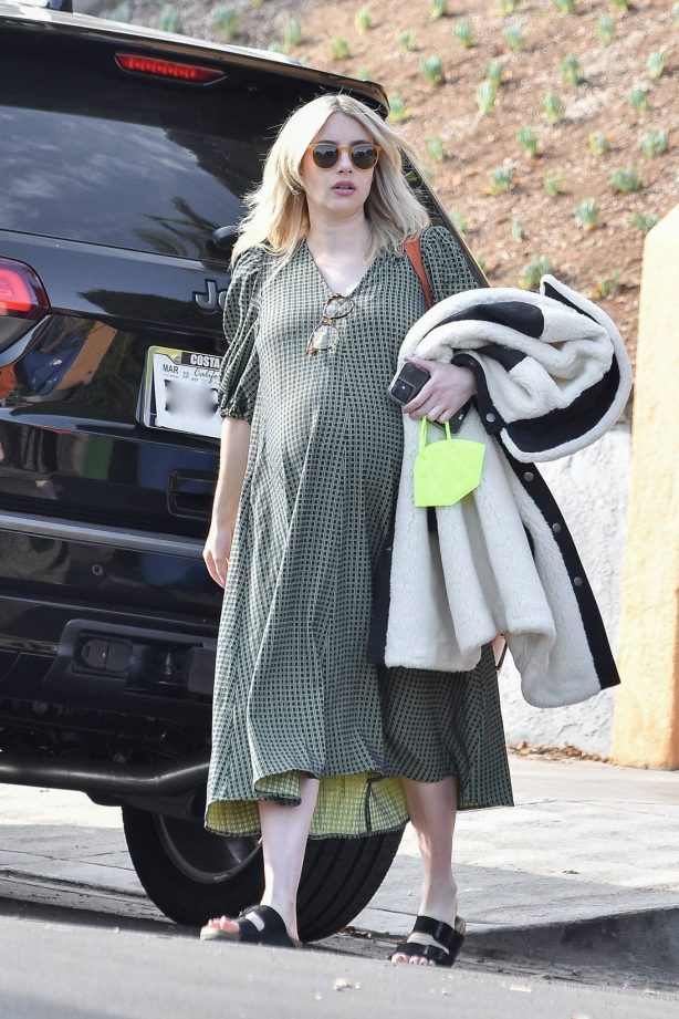 Emma Roberts - In a green midi dress heads to an appointment in Los Angeles
