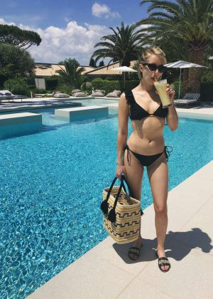 Emma Roberts in Black Bikini at a Pool in Saint-Tropez