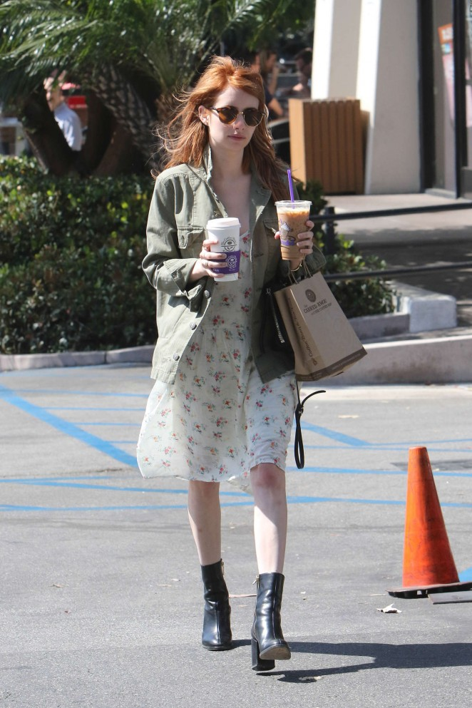 Emma Roberts in floral print dress out in West Hollywood