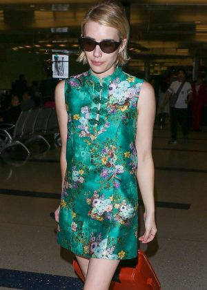 Emma Roberts in Green Dress - Arrives at LAX airport in Los Angeles