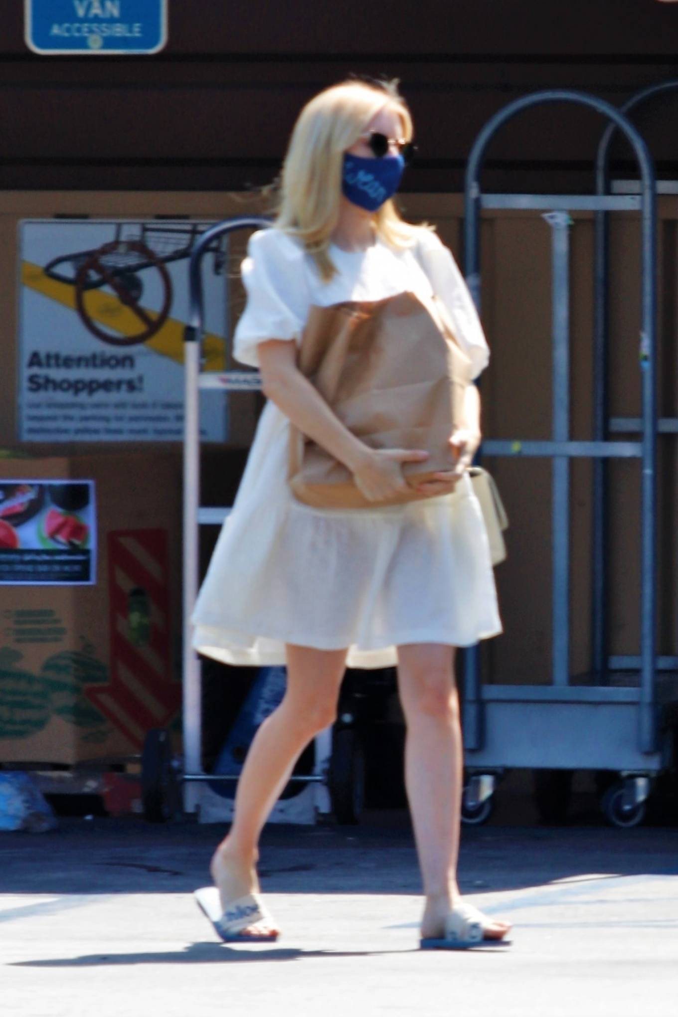 Emma Roberts - In white dress out in Los Angeles