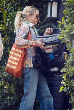 Emma Roberts - Out with her newborn baby boy Rhodes in Los Angeles